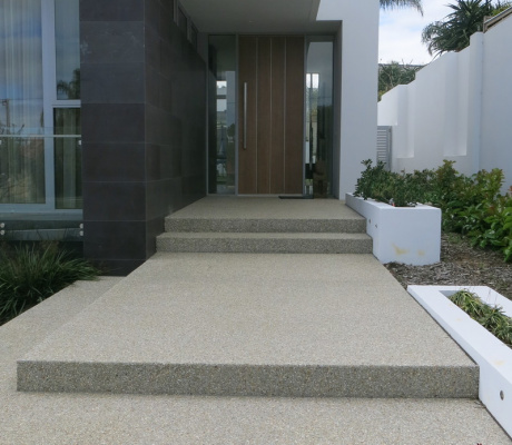 A light exposed aggregate pathway down the side of a Perth house.