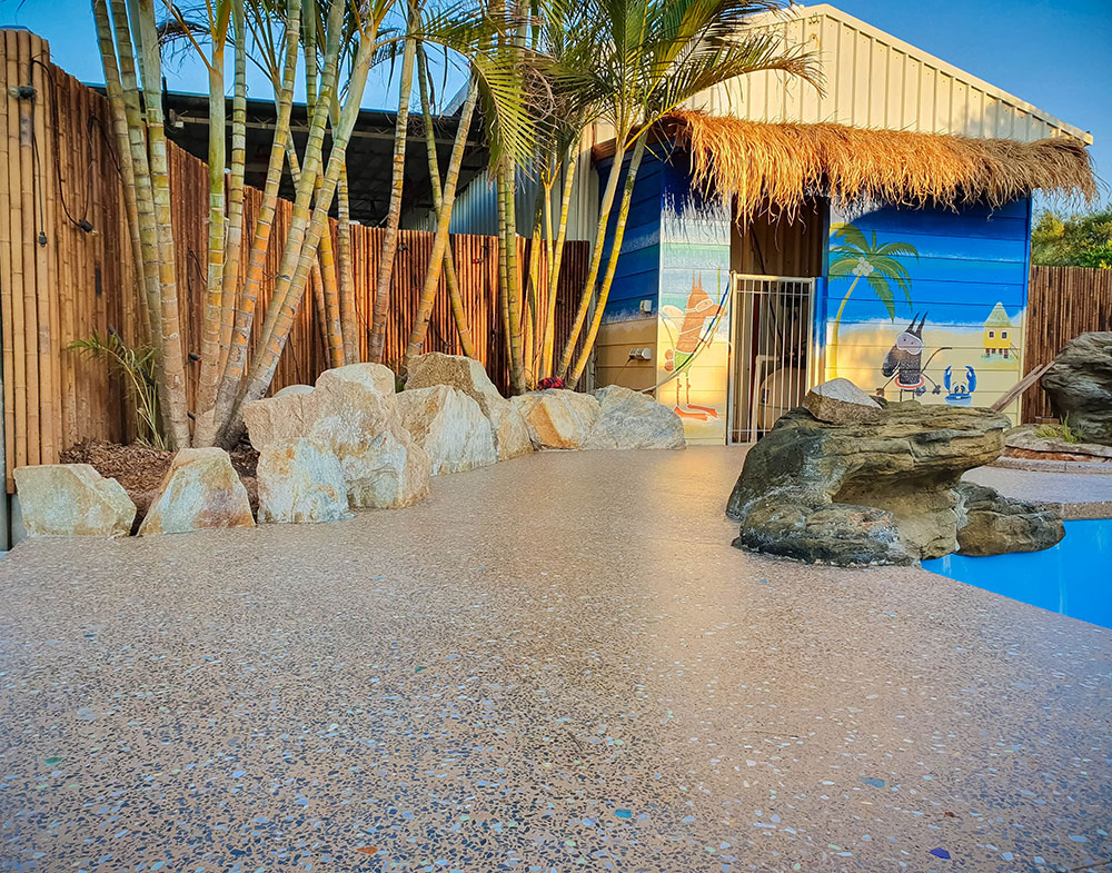 pool area with decorative concrete